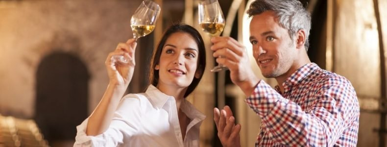 Man and a woman toast wine